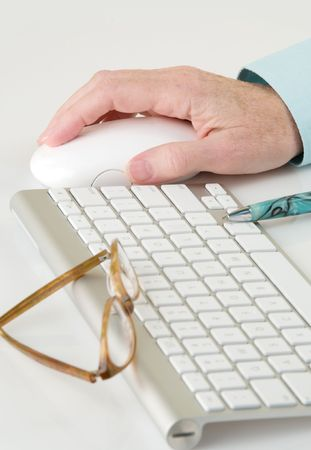 sleek: Sleek, modern computer keyboard and mouse with turquoise pen, eyeglasses and female hand Stock Photo