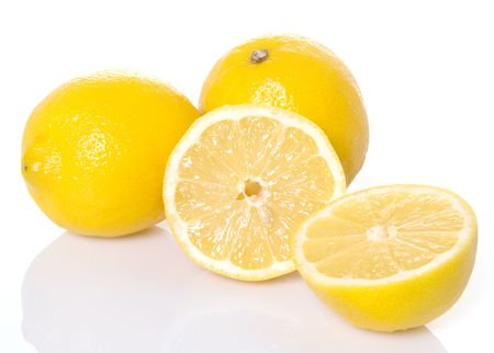 Lemons with one sliced in half Imagens