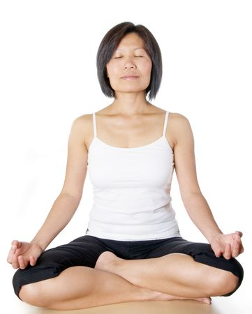 Woman sitting in the lotus pose photo