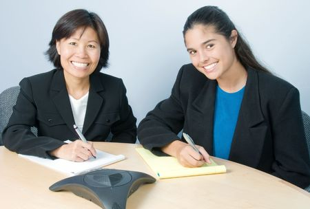 Beautiful, confident businesswomen enjoying a productive meeting Stock Photo