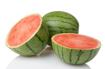 Two mini watermelons with one sliced in two