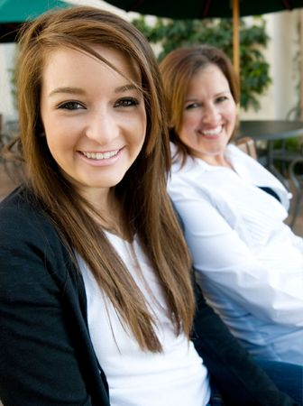 Mother and daughter sitting together at outdoor cafe Stock Photo - 5430470
