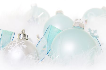 Pastel turquoise Christmas ornaments with snowy feathers Stock Photo