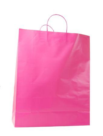 Pink shopping bag on white background Imagens