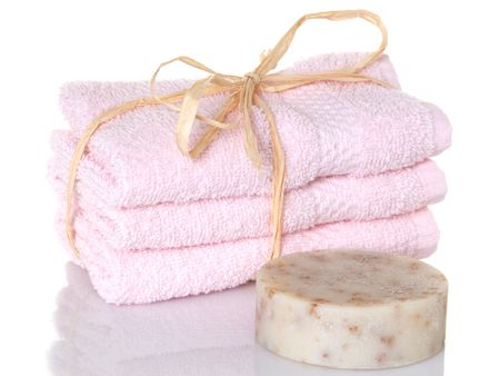 Pink towelettes with a bar of oatmeal soap