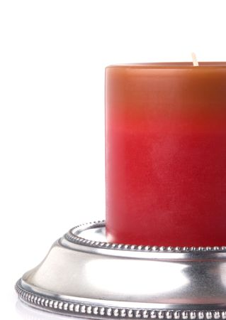 candle holder: Red candle on beaded pewter candle holder Stock Photo