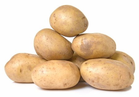 russet: Russet Potatoes stacked on top of each other