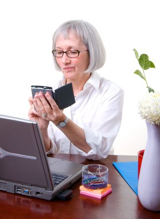 calandar: Senior businesswoman working on her calendar