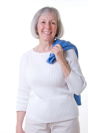 chinos: Smiling senior lady wearing a casual white sweater and stone colored chinos