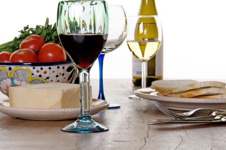 Food and wine go on the table in anticipation of a meal Stok Fotoğraf