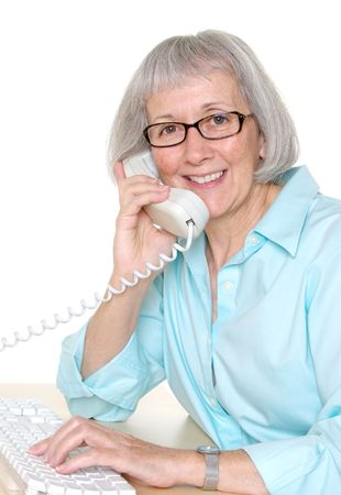 telephone: Smiling senior businesswoman talking on the telephone Stock Photo
