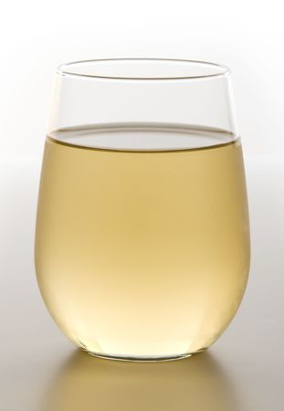 Stemless glass of chilled white wine Imagens