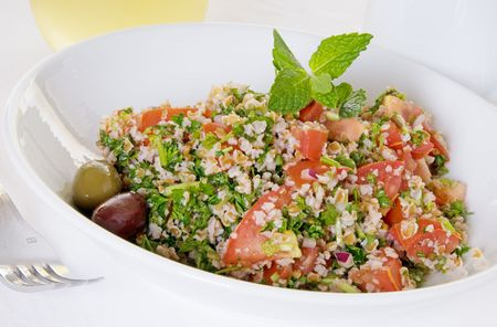 Color rich tabouli salad in white bowl