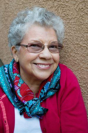 Beautiful senior lady with sweet grandmotherly smile. photo
