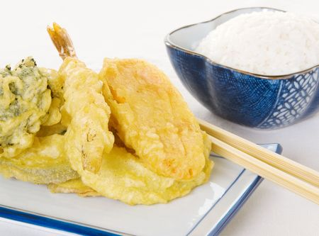 Tempura on a ceramic plate with a bowl of rice on the side