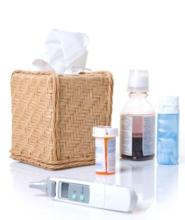 stomache: Tissues, thermometer, and remedies for the flu or a cold Stock Photo