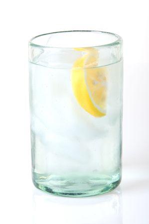 Glass of refreshing ice water with lemon wedge