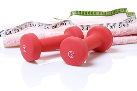 Weights with towel and measuring tape