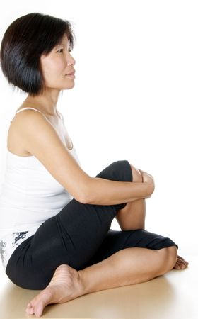 Healthy middle age woman in yoga pose photo