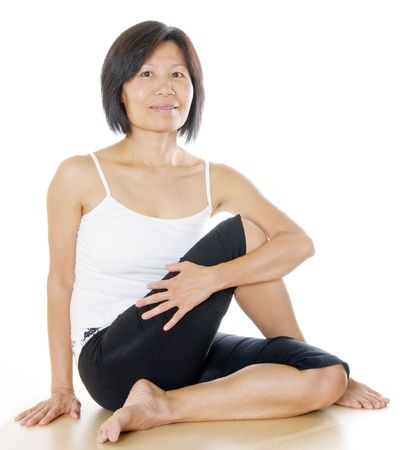 Healthy middle age lady in yoga pose photo