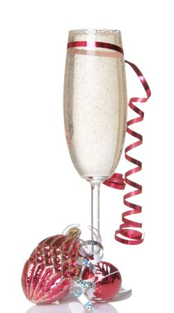 Glass of champagne with Christmas ornaments