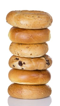 Half dozen freshly baked bagels stacked on top of each other