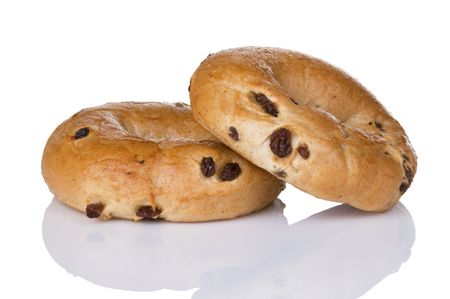 Two freshly baked cinnamon raisin bagels