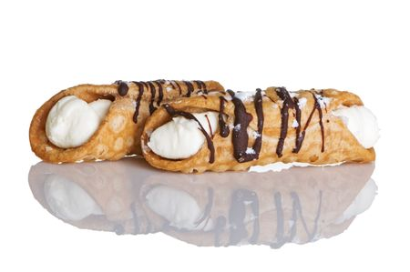 Two cream filled, delicious cannoli photo