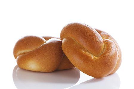 Freshly baked, golden brown challah rolls