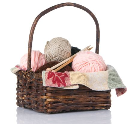 Basket containing balls of yarn and bamboo knitting needles Stok Fotoğraf