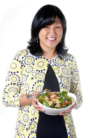 Beautiful middle age woman with a bowl of pasta salad