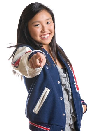 Pretty, high energy teen girl wearing school jacket and pointing at the camera