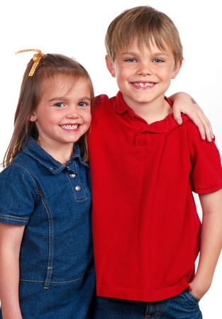 Young brother and sister with arms around each other