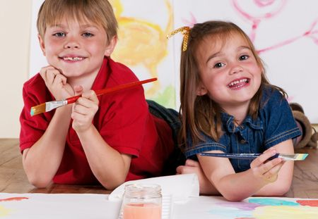 Little boy and girl enjoying painting together