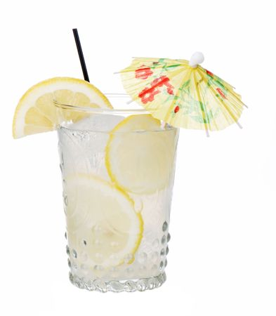 Antique glass of lemonade with umbrella
