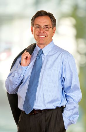 Middle age businessman wearing suit and tie Imagens