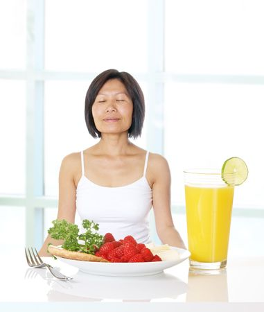 Woman feeling gratitude for health, prosperity, and fresh food