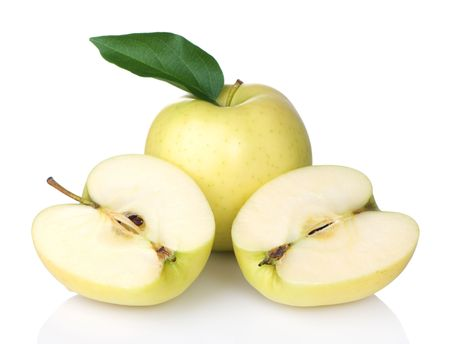 Golden Delicious apples with one sliced in half Stock Photo - 7234336