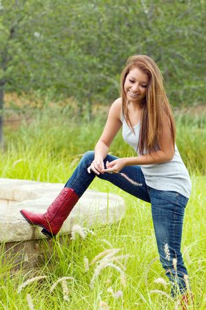 Pretty teen girl wearing red cowboy boots