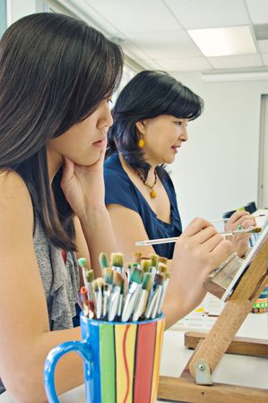 Art class with teen girl and adult