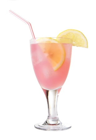 Glass of pink lemonade with ice and lemon wedges