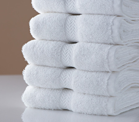 A stack of clean, white hotel towels
