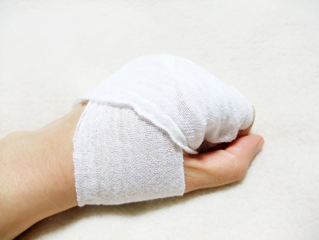 Hand wound with a bandage