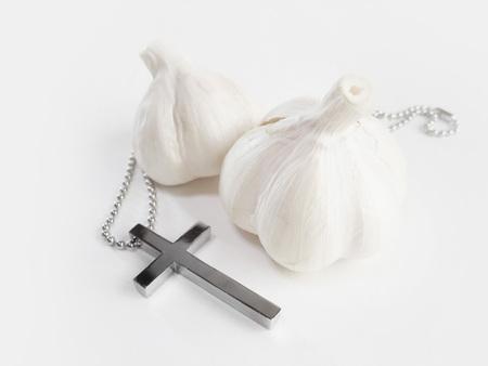 Garlic and crucifix 写真素材
