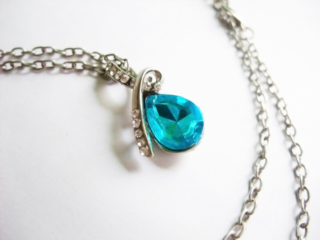 Necklace with a blue jewel
