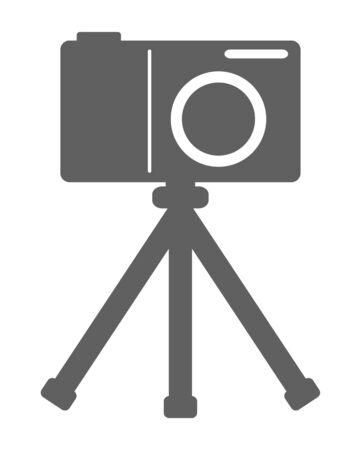 A camera with a tripod. 写真素材
