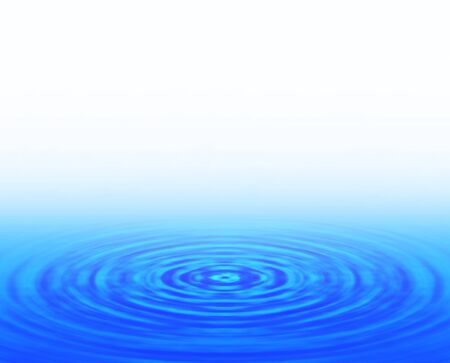 Ripples spreading on the water surface Фото со стока