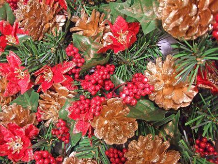Poinsettia and pine cones