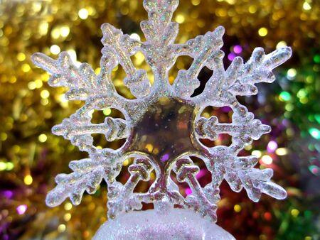 A transparent plastic snowflake ornament Banco de Imagens - 142623173