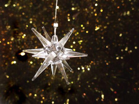 A transparent star-shaped Christmas ornament